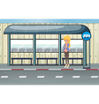 A girl standing at the waiting shed vector image vector image