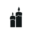 Two candles simple black icon on white background vector image