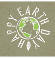 Happy Earth Day Grunge lettering with Earth symbol vector image vector image