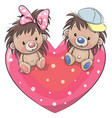 two cute hedgehogs on a heart vector image