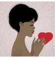 Beautiful african american woman with heart vector image