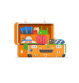travel suitcase full of things vector image