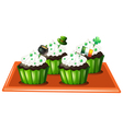 A tray with four chocolate cupcakes vector image