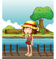 A girl eating an ice cream at the bridge vector image
