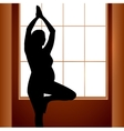 Pregnant woman in yoga position vector image