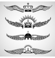 Wings with crowns emblems set vector image vector image