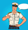 smiling sea captain showing thumb up pop art vector image