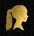 Silhouette of little girl face in gold color vector image