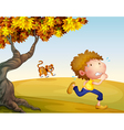 A boy running with a tiger at his back vector image
