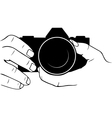 Camera in hands vector image vector image