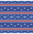 blue knitted seamless pattern with red and white vector image