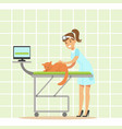 smiling female veterinarian examining cat in vet vector image