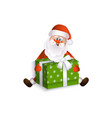 santa claus sitting and holding a christmas gift vector image
