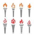 Set of flaming torches isolated on white vector image