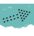 Flock of birds flying in the sky in an arrow vector image