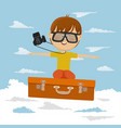 cute little boy flying on suitcase vector image