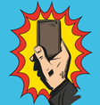 Mobile phone rings in hand Comic book vector image vector image