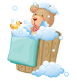 A bear inside the pail full of bubbles vector image