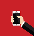 Hand holding white smartphone on red background vector image