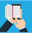 hand holding a mobile phone with an open book on vector image vector image