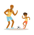 smiling man and boy playing soccer dad and son vector image