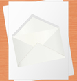 Blank White Paper And Envelope On Oak Table vector image