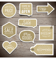 Stickers on rustic wood background for retail vector image