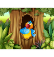 A parrot inside a tree hollow vector image