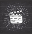 clapperboard vintage label hand drawn sketch vector image