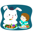 little cute boy eating vegetable with white rabbit vector image