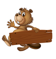 A beaver holding a wooden signboard vector image vector image