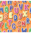 Seamless background with cartoon colored letters vector image
