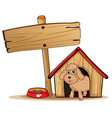 A cute dog at his dog house vector image vector image