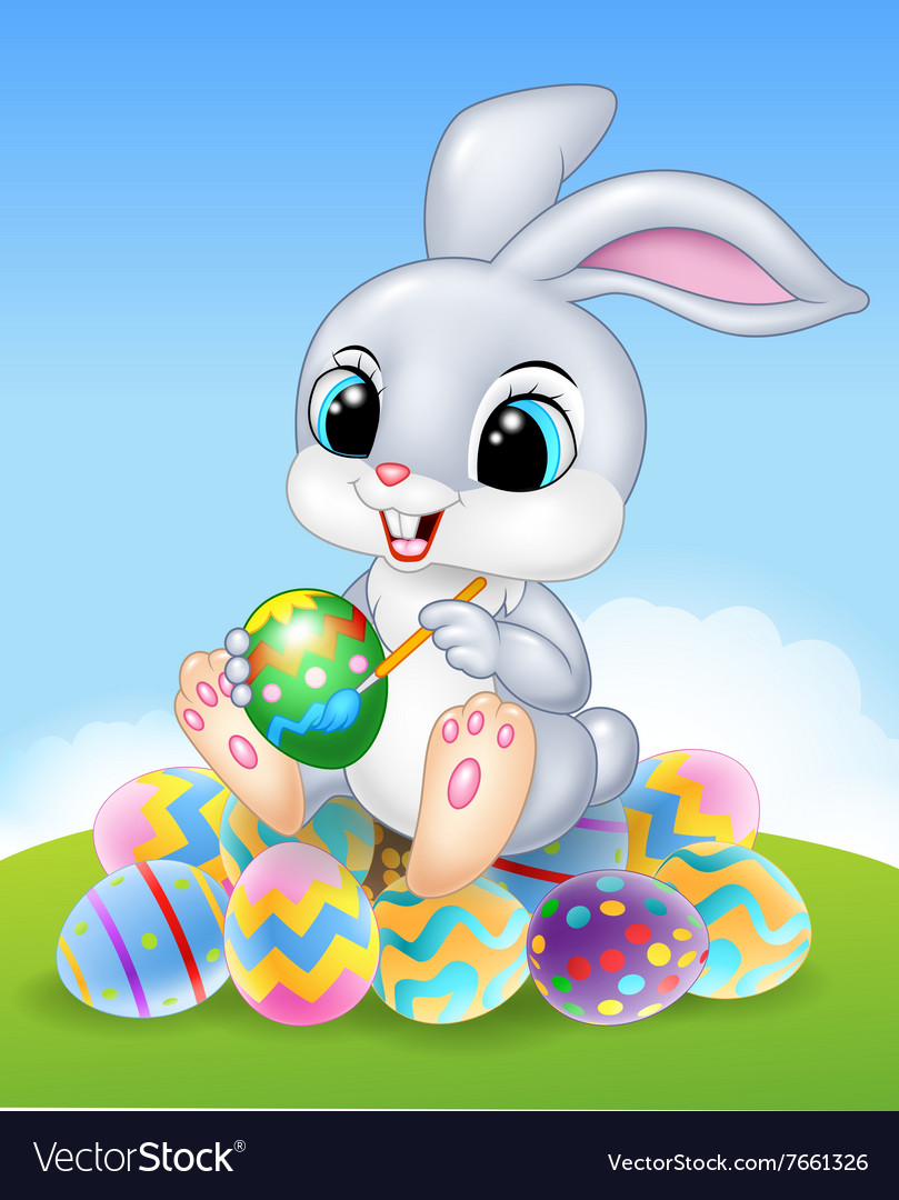 Cartoon easter bunny painting an egg on the easter vector