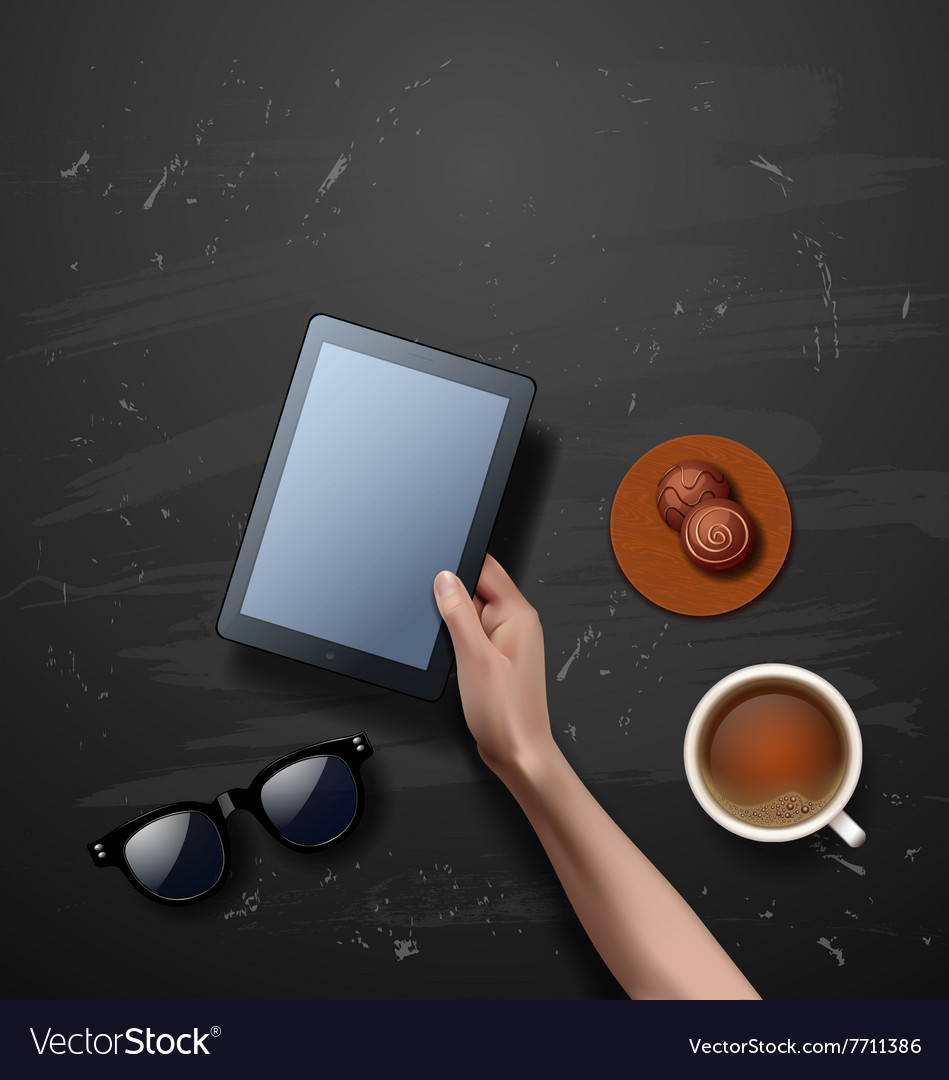 Hands holding tablet computer with cup of coffee vector