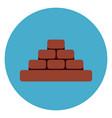 heap of brick blocks icon web button on round blue vector image