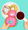 delicious donuts in glaze with cup of hot coffee vector image