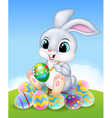 Cartoon Easter Bunny painting an egg on the easter vector image