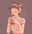 beautiful young woman holding paper cup of coffee vector image