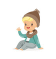 cute little blonde boy in a brown hat and scarf vector image