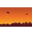 Silhouette oof city and ufo in sky vector image