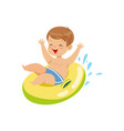 cute boy having fun floating with lifebuoy vector image