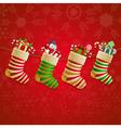 Hanging christmas socks with present vector image