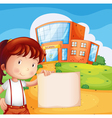 A kid in front of the school with an empty paper vector image vector image