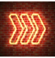 Neon arrow on wall vector image