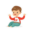 cute smiling little boy dressed in jeans and vector image