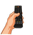 tv remote control holding in hand vector image