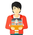Man holding house model vector image vector image
