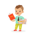 cute boy reading a book while standing and holding vector image