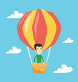 young man flying in hot air balloon vector image vector image